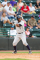 Miguel Andujar (5) of the Charleston RiverDogs at bat against the Hickory Crawdads at L.P. Frans Stadium on May 24, 2014 in Hickory, North Carolina.  The Crawdads defeated the RiverDogs 7-3.  (Brian Westerholt/Four Seam Images)