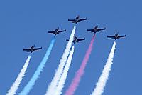 Six L-39 Albatross aircraft of the Patriots flight demonstration team zoom sykward in a delta formation.