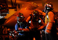 110917-N-DR144-049 PACIFIC OCEAN (Sept. 17, 2011) Sailors assigned to Air Department's V-3 Division battle a simulated aircraft fire in the hangar bay during a general quarters drill aboard Nimitz-class aircraft carrier USS Carl Vinson (CVN 70). Carl Vinson is underway conducting operations off the coast of Southern California.  U.S. Navy photo by Mass Communication Specialist 2nd Class James R. Evans (RELEASED)