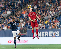 FOXBOROUGH, MA - AUGUST 31: Patrick Mullins #13 of Toronto FC heads the ball during a game between Toronto FC and New England Revolution at Gillette Stadium on August 31, 2019 in Foxborough, Massachusetts.