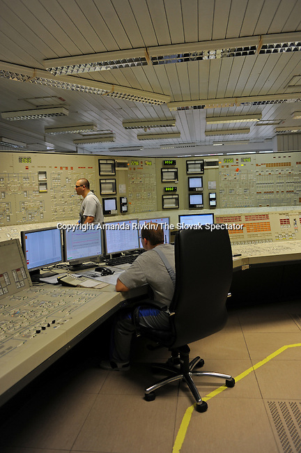 Workers inside the control room in the Mochovce Nuclear Power Plant in Mochovce, Slovakia on June 18, 2010.  Construction began during the communist regime in the 1970s, but the Mochovce Nuclear Power Plant was not complete until after the revolution in 1989 and is currently run by the Italian power company Enel and the Slovak Electric Company.