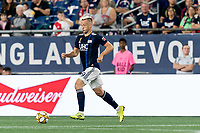 FOXBOROUGH, MA - SEPTEMBER 21: Antonio Mlinar Delamea #19 of New England Revolution dribbles during a game between Real Salt Lake and New England Revolution at Gillette Stadium on September 21, 2019 in Foxborough, Massachusetts.