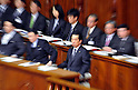 File photo: June 2, 2011, Tokyo, Japan - Japanese Prime Minister Naoto Kan, front row right, listens to an opposition lawmaker during a plenary session for a non-confidence vote in the Diet lower house in Tokyo on Thursday, June 2, 2011. Kan officially announced his resignation on August 26, 2011. (Photo by AFLO)