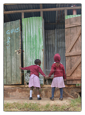 NGO Photography Workshop in the Lenana Slum of Nairobi, Kenya.Photo &copy;Suzi Altman In 2014, Suzi Altman traveled to Kenya at the invitation of The Supply, an NGO that operates a school in the Lenana slum, near Nairobi.<br />  <br /> While in residence at the Kevjumba School, Altman lead a photography class that taught self-identity and community identity utilizing photography as a tool, which helped children &quot;see&quot; the world they live in, as well as its relation to the broader world outside their community. Together, photography and the written word were powerful instruments for the students to express themselves. The students took photographs of themselves and their community, highlighting positive aspects in each. Through the workshop, the students&rsquo; voices became stronger, and they discovered commonalities with other cultures around the world, like the importance of family, shelter, education, and religion.<br />  <br /> While in the Lenana slum, Suzi photographed the children and places she encountered in the community. The subjects are workshop participants and other community members. What became most evident among those she visited were the tremendous sense of pride in their homes, communities, and schools, and the moments of happiness, which is evoked in the resulting series of photographs.