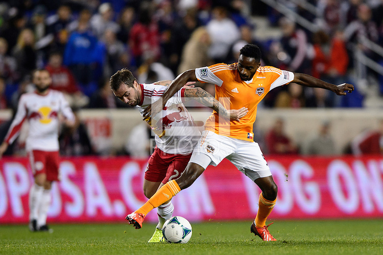 Jonny Steele (22) of the New York Red Bulls and Warren Creavalle (5) of the Houston Dynamo battle for the ball. The Houston Dynamo defeated the New York Red Bulls 2-1 (4-3 on aggregate) in overtime of the second leg of the Major League Soccer (MLS) Eastern Conference Semifinals at Red Bull Arena in Harrison, NJ, on November 6, 2013.