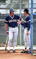 Boston Red Sox Wade Boggs with coach Rick Burleson during spring training circa 1992 at Chain of Lakes Park in Winter Haven, Florida.  (MJA/Four Seam Images)