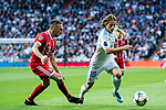 Luka Modric of Real Madrid fights for the ball with Franck Ribery of FC Bayern Munich during the UEFA Champions League Semi-final 2nd leg match between Real Madrid and Bayern Munich at the Estadio Santiago Bernabeu on May 01 2018 in Madrid, Spain. Photo by Diego Souto / Power Sport Images