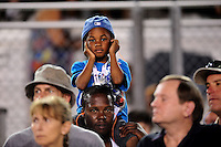 Sept. 17, 2010; Concord, NC, USA; A young NHRA fan plugs his ears as he sits on his dads shoulders during qualifying for the O'Reilly Auto Parts NHRA Nationals at zMax Dragway. Mandatory Credit: Mark J. Rebilas/
