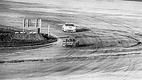 #5 Porsche 935 of  Bob Akin, John O'Steen, and Hans Joachim Stuck, 5th place, and #48 Porsche 935 of Stefan Johansson, Hans Heyer, and Maurico DeNarvaez, 1st pace, winner, aerial view from Goodyear blimp, 3rd place,  12 Hours of Sebring, IMSA Camel GT race, Sebring International Raceway, Sebring, Florida, March 24, 1984.  (Photo by Brian Cleary/www.bcpix.com)
