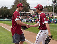 STANFORD, CA - March 11, 2012:  Stanford's Andrew Luck and Mark Appel shake hands before the start of the  baseball against Rice at Sunken Diamond.