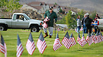 Volunteers place flags on the graves of veterans at the Lone Mountain Cemetery in Carson City, Nev., on Friday, May 25, 2012. More than 1,400 flags were placed in honor of Memorial Day..Photo by Cathleen Allison
