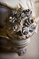 Detail shot of carved wooden bed post