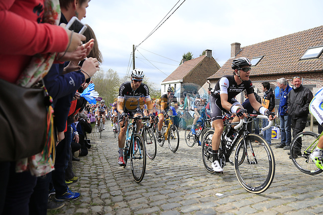 The peleton, including Jasper Stuyven (BEL) Trek Factory Racing, climb the Molenberg during the 2014 Tour of Flanders, Belgium.<br /> Picture: Eoin Clarke www.newsfile.ie