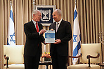 "Bank of Israel Governor Stanley Fischer (L) poses with Israeli President Shimon Peres (R) while submitting the Bank of Israel report to Peres at the Presidential Residence in Jerusalem, Sunday, April 19, 2009. Stanley Fischer declared that ""the report says we are dealing with the current crisis relatively well"", although he did stress that he expects the decline to continue and that he believes that the Israeli economy has yet to reach its lowest point. Photo By: Emil Salman / JINI"