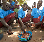 Students share their lunch at the Loreto Primary School in Rumbek, South Sudan. The school, run by the Institute for the Blessed Virgin Mary--the Loreto Sisters--of Ireland, has also opened its compound to hundreds of nearby villagers facing hunger because of ongoing conflict and climate change.