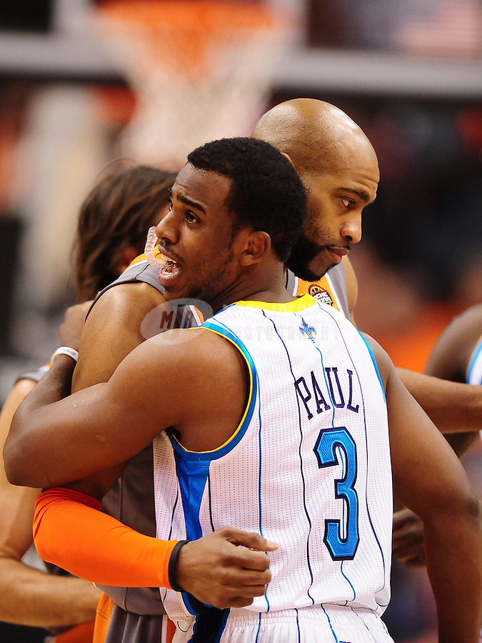 Mar. 25, 2011; Phoenix, AZ, USA; New Orleans Hornets guard (3) Chris Paul greets Phoenix Suns guard Vince Carter at the US Airways Center. The Hornets defeated the Suns 106-100. Mandatory Credit: Mark J. Rebilas-