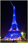 Eiffel Tower at night, lit with blue light [La Tour Eiffel par nuit en lumière bleue]