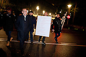 WARSAW, POLAND, December 24, 2016<br /> On Christmas eve opposition MP's from PO (Civic Platform) party are coming from Sejm (Polish parliament), holding a &quot;freedom decalogue&quot; to visit their supporters outside. Anti-government demonstrators are spending Christmas eve on the street by the Sejm, Polish parliament, occupied by the opposition MP's since December 17.<br /> The opposition objects to government plans to ban most of journalists from  covering parliamentary proceedings. The opposition MP's protest delayed a budget 2017 vote, which was later held away from the main parliament chamber and is now considered unlawful, which sparks further protest. The standoff has started December 17 and is bound to continue until the next parliamentary session scheduled for January 11.<br /> (Photo by Piotr Malecki / Napo Images)<br /> ****<br /> WARSZAWA, 24.12.2016. <br /> Wigilia przed sejmem. Poslowie z PO ida z sejmu trzymajac &quot;dekalog wolnosci&quot; .Poslowie opozycji z partii PO i Nowoczesna pozostaja w sali planarnej Sejmu,  nie opuszczajac jej od 17/12 i planuja pozostanie do nastepnego posiedzenia 11 stycznia. Jest to dzialanie w obronie wolnosci mediow i przeciwko uchwaleniu budzetu przez partie rzadzaca w innej sali, bez obecnosci poslow opozycji. <br /> Fot. Piotr Malecki / Napo Images<br /> <br /> ###ZDJECIE MOZE BYC UZYTE W KONTEKSCIE NIEOBRAZAJACYM OSOB PRZEDSTAWIONYCH NA FOTOGRAFII### ###