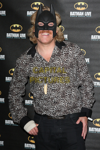 LEIGH FRANCIS aka KEITH LEMON.Opening Night of 'Batman Live' at the 02 Arena, London, England..August 24th 2011.half length black grey gray leopard print top bandage moustache mustache facial hair mask.CAP/ROS.©Steve Ross/Capital Pictures