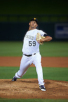 Salt River Rafters pitcher Carlos Estevez (59) delivers a pitch during an Arizona Fall League game against the Scottsdale Scorpions on October 14, 2015 at Salt River Fields at Talking Stick in Scottsdale, Arizona.  Salt River defeated Scottsdale 5-3.  (Mike Janes/Four Seam Images)