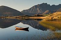 Traditional wooded row boat in lake, Vestvågøy, Lofoten Islands, Norway