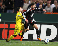 Chris Pontious#13 of D.C. United gets past Dilly Duka#11 of the Columbus Crew during the opening match of the 2011 season at RFK Stadium, in Washington D.C. on March 19 2011.D.C. United won 3-1.