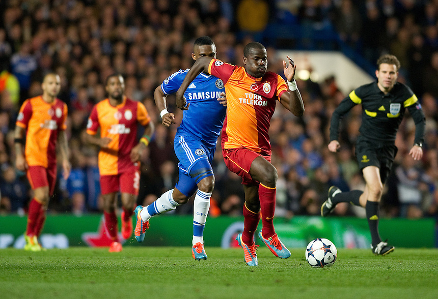 Galatasaray's Emmanuel Eboue holds off the challenge from Chelsea's Samuel Eto'o<br /> <br /> Photo by Ashley Western/CameraSport<br /> <br /> Football - UEFA Champions League First Knockout Round 2nd Leg - Chelsea v Galatasaray - Tuesday 18th March 2014 - Stamford Bridge - London<br />  <br /> &copy; CameraSport - 43 Linden Ave. Countesthorpe. Leicester. England. LE8 5PG - Tel: +44 (0) 116 277 4147 - admin@camerasport.com - www.camerasport.com