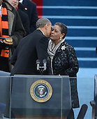 President Barack Obama kisses Myrlie Evers-Williams before being sworn-in for a second term as the President of the United States by Supreme Court Chief Justice John Roberts during his public inauguration ceremony at the U.S. Capitol Building in Washington, D.C. on January 21, 2013.     .Credit: Pat Benic / Pool via CNP