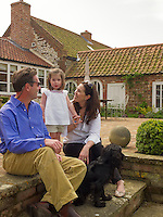 Monica Vinader and her family sitting on the terrace of their country house in Norfolk