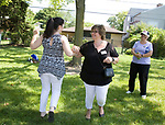 "Neighbors dance to ""It's a Wonderful World"" during the Family Peace Fest for Hope and Harmony, in Morton Grove, Saturday, August 19, 2017. [Photo by Karen Kring]"
