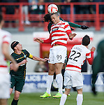 Mikael Antoine-Curier wins the ball from Jason Denayer as Scott Brown looks up