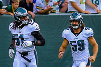 Philadelphia Eagles defensive end Steven Means (51) and linebacker Joe Walker (59) during a preseason football game against the Green Bay Packers on August 10, 2017 at Lambeau Field in Green Bay, Wisconsin. Green Bay defeated Philadelphia 24-9.  (Brad Krause/Krause Sports Photography)