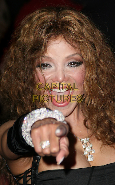 "LA TOYA JACKSON.Attending the UK film premiere of ""The Imaginarium Of Doctor Parnassus"" at the Empire Leicester Square cinema, London, England, UK, October 6th 2009..portrait headshot black Latoya hand finger gesture pointing necklace silver ring bracelets mouth open smiling cleavage .CAP/JIL.©Jill Mayhew/Capital Pictures"