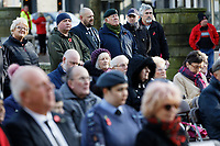 Pictured: A war veteran and other people observe two minutes silence at Castle Square Gardens in Swansea, Wales, UK. Monday 11 November 2019<br /> Re: Armistice Day, a service to commemorate those who lost their lives in conflict has been held at Castle Square Gardens in Swansea, Wales, UK.