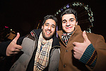 © Joel Goodman - 07973 332324 . 31/12/2013 . Manchester , UK . Dan Anwar (19) and Ali Qasim (17) , both from London , both correct . Revellers gather in Piccadilly Gardens ahead of the New Years fireworks display to usher in 2014 . Photo credit : Joel Goodman