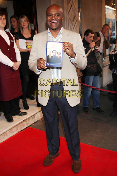 Kriss Akabusi.The press night of 'The King's Speech' at Wyndhams Theatre, London, England..March 27th, 2012.full length blue shirt grey gray suit jacket smiling.CAP/JEZ  .©Jez/Capital Pictures.