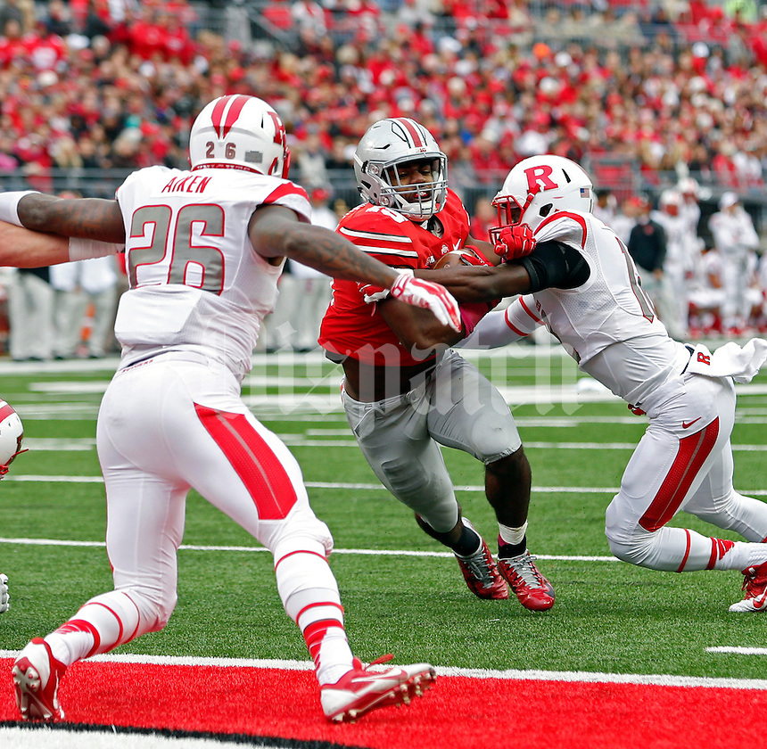 Ohio State Buckeyes running back Ezekiel Elliott (15) scores on a touchdown run against Rutgers Scarlet Knights defense during the 1st quarter of their game at Ohio Stadium on October 18, 2014.   (Dispatch photo by Kyle Robertson)
