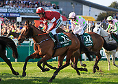 14h April 2018, Aintree Racecourse, Liverpool, England; The 2018 Grand National horse racing festival sponsored by Randox Health, day 3; Eventual race winner Tiger Roll ridden by Davy Russell after the water jump in The Grand National
