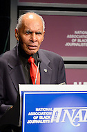 "January 26, 2012  (Washington, DC)  Tuskegee Airman Rosco Brown speaks to the audience at the 2012 National Association of Black Journalists (NABJ) Hall of Fame Induction Ceremony at the Newseum in Washington.  Brown served as the commanding officer of the 100th Fighter Squadron, 332nd Fighter Group.  He recently consulted on the film ""Red Tails"" starring Cuba Gooding, Jr. (Photo by Don Baxter/Media Images International)"