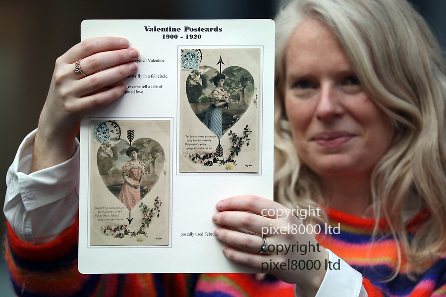Pic shows: 1900 -1920 valentine cards<br /> <br /> Valentine's Cards  through the ages<br /> collection at an Exhibition in London today  13.2.19<br /> <br /> A selection of the world's oldest Valentine's Day cards are on display until 16th February at Stampex International, the UK's largest stamp collecting exhibition, at the Business Design Centre, Islington. Collected by Judith Holder over the last 50 years, some date back as far as 1720.<br /> <br /> <br /> Cards being held by Susan Wylie who is overseeing the exhibition <br /> <br /> <br /> <br /> <br /> pic by Gavin Rodgers/Pixel8000