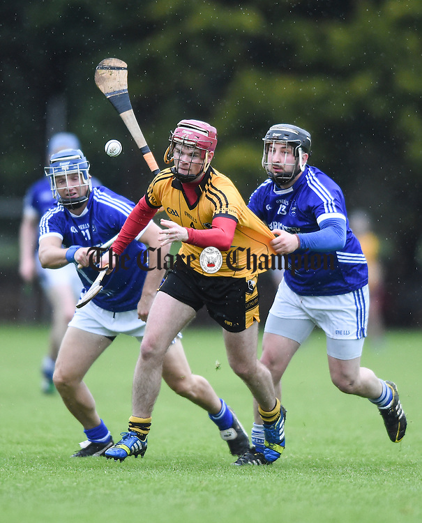 Cillian Fennessy of Clonlara in action against Gearoid Considine and Barry Gleeson of Cratloe during their Clare Champion Cup game at Cratloe. Photograph by John Kelly.