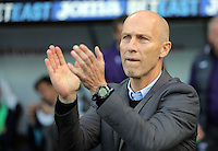 Swansea manager Bob Bradley applauds supporters prior to the Premier League match between Swansea City and Watford at The Liberty Stadium on October 22, 2016 in Swansea, Wales, UK.