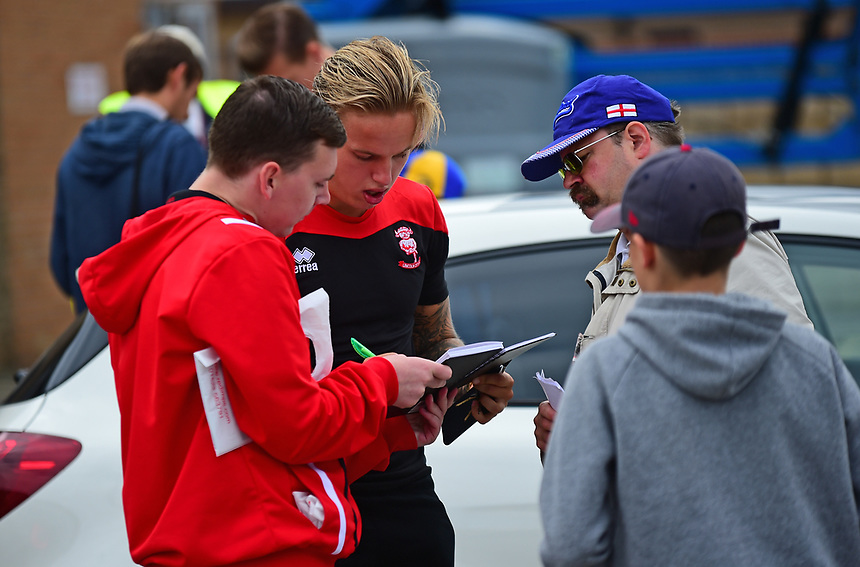 Lincoln City's Jordan Maguire-Drew signs autographs as he arrives at the match<br /> <br /> Photographer Andrew Vaughan/CameraSport<br /> <br /> The EFL Sky Bet League Two - Lincoln City v Morecambe - Saturday August 12th 2017 - Sincil Bank - Lincoln<br /> <br /> World Copyright &copy; 2017 CameraSport. All rights reserved. 43 Linden Ave. Countesthorpe. Leicester. England. LE8 5PG - Tel: +44 (0) 116 277 4147 - admin@camerasport.com - www.camerasport.com