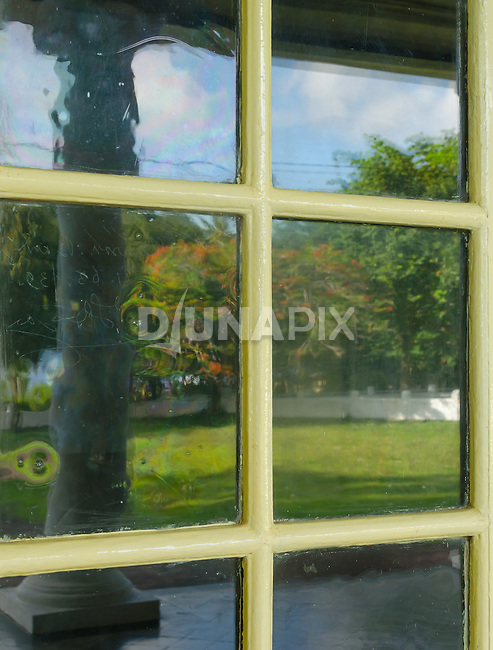 Reflection in old warped glass in the VOC Palace, Banda Neira.