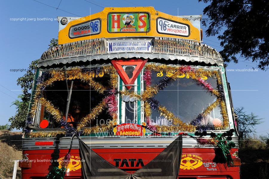 "Südasien Asien Indien IND , bemalter und geschmueckter TATA Lastwagen auf Strasse.  .South Asia India , colorful and painted TATA truck on the road.  -  transport vehicle .  [ copyright (c) Joerg Boethling / agenda , Veroeffentlichung nur gegen Honorar und Belegexemplar an / publication only with royalties and copy to:  agenda PG   Rothestr. 66   Germany D-22765 Hamburg   ph. ++49 40 391 907 14   e-mail: boethling@agenda-fototext.de   www.agenda-fototext.de   Bank: Hamburger Sparkasse  BLZ 200 505 50  Kto. 1281 120 178   IBAN: DE96 2005 0550 1281 1201 78   BIC: ""HASPDEHH"" ,  WEITERE MOTIVE ZU DIESEM THEMA SIND VORHANDEN!! MORE PICTURES ON THIS SUBJECT AVAILABLE!! INDIA PHOTO ARCHIVE: http://www.visualindia.net ] [#0,26,121#]"