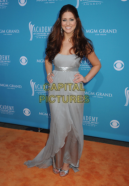 Rachel Reinert of Gloriana .45th Annual Academy Of Country Music Awards held at the MGM Grand Garden Arena, Las Vegas, NV, USA..April 18th, 2010.full length grey gray maxi dress hand on hip.CAP/ADM/BP.©Byron Purvis/AdMedia/Capital Pictures.