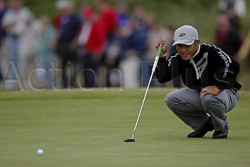 17 July 2004: Japanese golfer Shigeki Maruyama (JPN) putts on the 4th green during the third round of The Open Championship played at Royal Troon, Scotland. Photo: Glyn Kirk/Action Plus...golf golfer putt putter putting 040717.British
