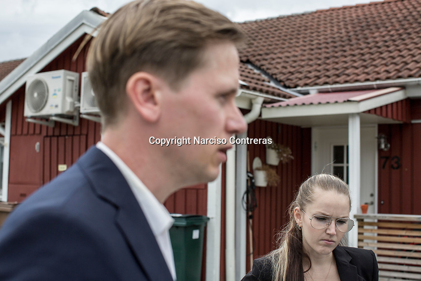 August 30, 2018: ROGER HEDLUND, a 38 years-old MP and member of the SD board in Gävle municipality for the Swedish Democrats (Sverigedemokraterna) and LIZ ZACHARIASSON, a 27 years-old member of the SD since 2009. They speak out to the media prior to a public debate held in Ockelbo city with members of the Social Democrats party (Socialdemokraterna) -not pictured-, Roger, a former worker of the steel industry, is running for the Gälve municipality, while Liz is running for the Ockelbo municipality respectively.