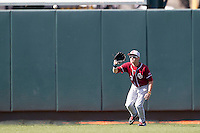 Oklahoma Sooners outfielder Craig Aikin #3 makes a catch against the Texas Longhorns in the NCAA baseball game on April 6, 2013 at UFCU DischFalk Field in Austin, Texas. The Longhorns defeated the rival Sooners 1-0. (Andrew Woolley/Four Seam Images).