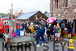 Sean Lynch and Dinny Cronin celebrate finding water during the parade last Sunday.